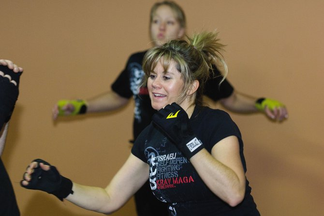 Student Stacey Luster works on her moves during a krav maga class.