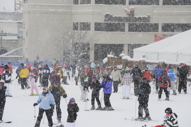 Skiers crowd the base Tuesday afternoon during a powder day at the Steamboat Ski Area. Standard & Poor's Ratings Services cited a ski area consistently rated in the top 10 as one reason for upgrading the city's bond rating.