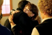 Bonnie Roesink receives a hug from her son, John Roesink, at her retirement party Friday at the Center of Craig.