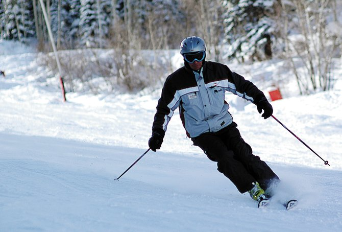 With his outside knee straight between his hip and ankle - not bent and tucked in against his inside leg - Bill McCawley demonstrates the proper way to make a turn with modern skis. Turning with the knee between the hip and ankle can help prevent ACL injuries.