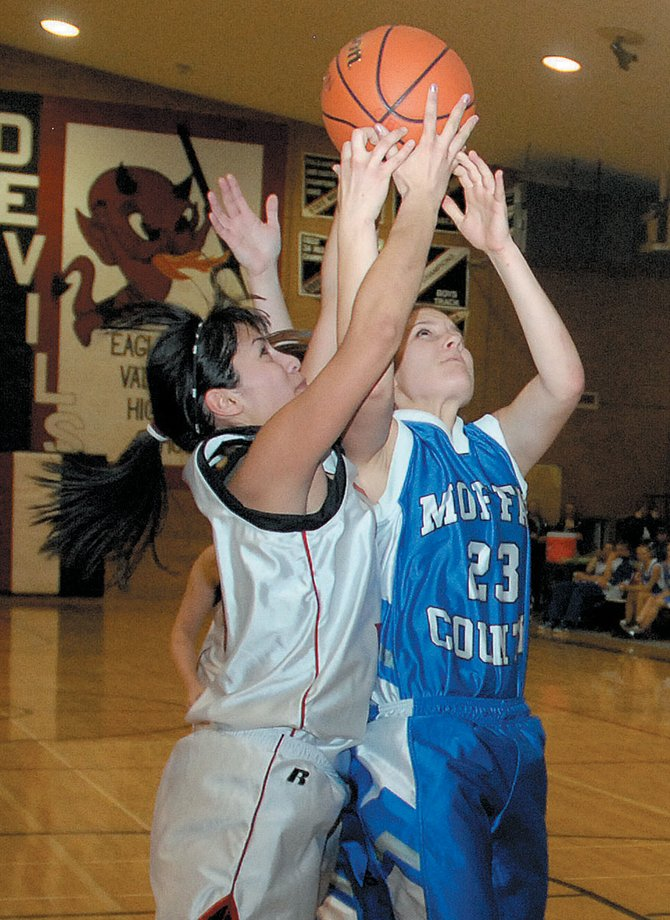Moffat County senior Ariel Sanchez, right, battles for a rebound during Friday's victory at Eagle Valley. The Bulldogs defeated the Huskies on Saturday, completing their two-game road trip with a sweep.