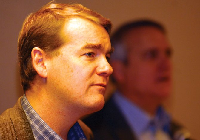 Former Denver Public Schools Superintendent Michael Bennet listens to a question from a concerned citizen during a pancake breakfast at the Sheraton Steamboat Resort on Monday morning. The meeting was part of a tour designed to introduce Bennet to the state. Bennet has been named by Gov. Bill Ritter (shown in the background) to replace Ken Salazar in the U.S. Senate. Salazar is expected to take the position of secretary of the interior in President-elect Barack Obama&#39;s Cabinet.