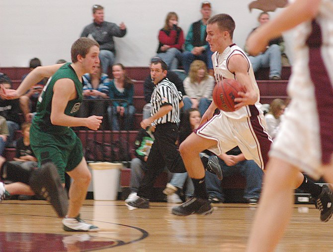 Alex Estes leads the way on a fast break Saturday as Soroco defeated Rangely to improve to 7-1 for the season. Estes and the Rams return to the court tonight as they travel to Moffat County to play the junior varsity squad. The girls team will play host to the Moffat County junior varsity.