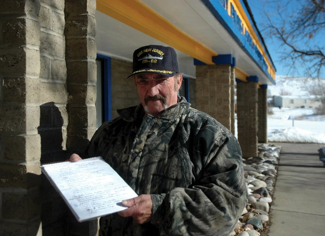 Craig resident Howdy Davis holds notes he's taken for a Colorado Northwestern Community College class on memoir writing. The non-credit section of the course takes place at American Legion Post No. 62 in Craig. Davis' memoirs include his childhood escapades in Pennsylvania and his experiences in the U.S. Navy.