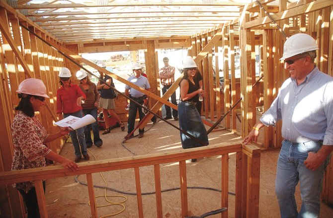 Future owners of units at First Tracks at Wildhorse Meadows take a hardhat tour at the construction site in September 2008. A group of local developers and businesspeople is questioning the legality of the city&#39;s affordable housing ordinances.