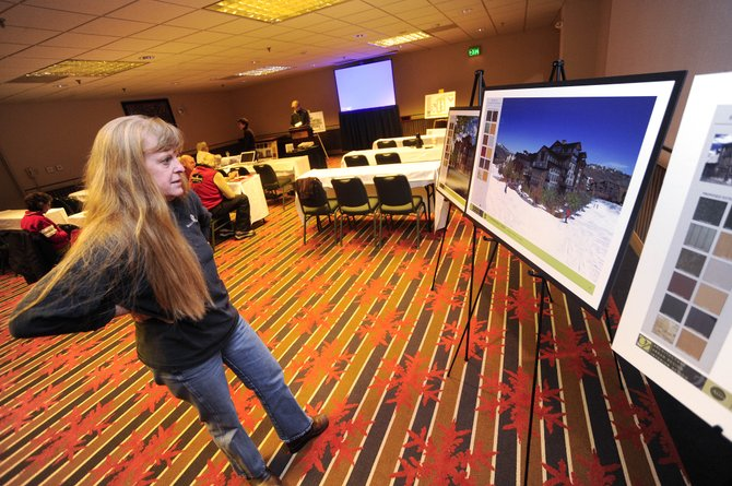 January DiTrani, with StructureTek, a company working with the Atira Group on base area redevelopment, looks at a rendering of the proposed Thunderhead Lodge on Thursday at the Sheraton Steamboat Resort.