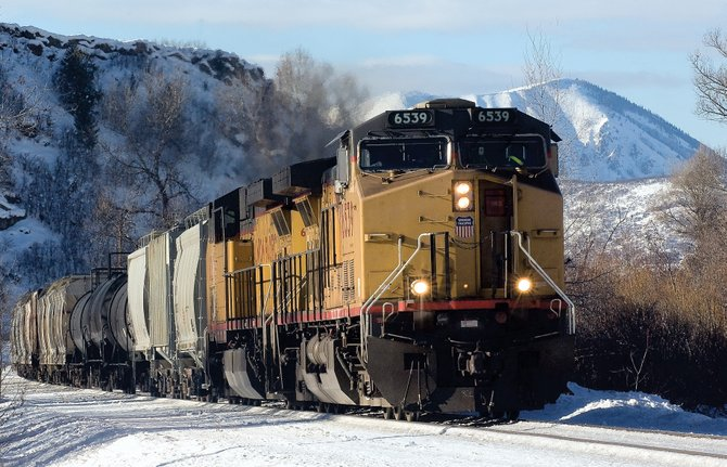 A Union Pacific train rolls through downtown Steamboat Springs in much the same way trains  have been  for the past 100 years.