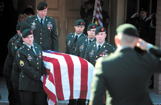 An honor guard bears the body of Sgt. 1st Class Richard Lopez to the waiting hearse  after his funeral Thursday at St. Rose Cathollic Church in Paso Robles, Calif. He died Jan. 5 after a fight outside a bar in downtown Steamboat Springs. The U.S. Army Special Forces veteran had earned a Purple Heart, among other awards, after serving in Iraq and Afghanistan.