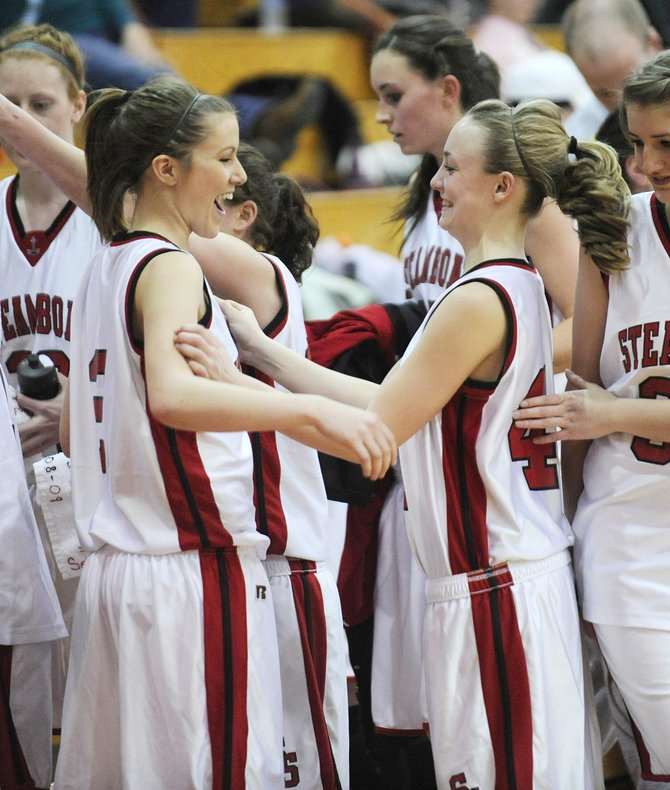 Steamboat Springs High School girls basketball player Matthia Duryea, right, celebrates with teammate Hannah Moore after their 51-42 victory against Delta High School on Saturday at Kelly Meek Gymnasium.