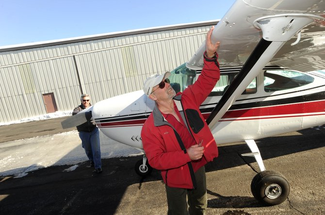 Flight student Jim Martin checks the wing of his aircraft before taking off with instructor Joe Birkinbine on Friday morning at the Steamboat Springs Airport.