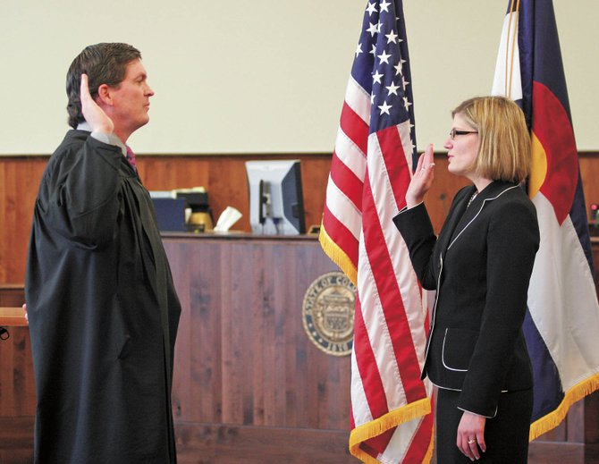 Michael O'Hara, left, Chief Judge for the 14th Judicial District, swears in new District Attorney Elizabeth Oldham during ceremonies at the Grand County Judicial Center on Wednesday in Hot Sulphur Springs.