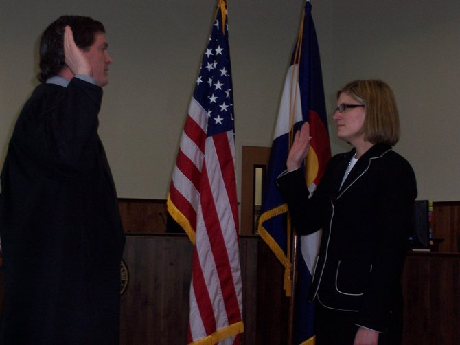 Michael O'Hara, left, chief judge of the 14th Judicial District, swears in Elizabeth Oldham, right, as the new 14th Judicial District Attorney on Wednesday in Grand County. Oldham, winner of the November general election, now has filled all office vacancies in the 14th, including a deputy district attorney's position in Craig.