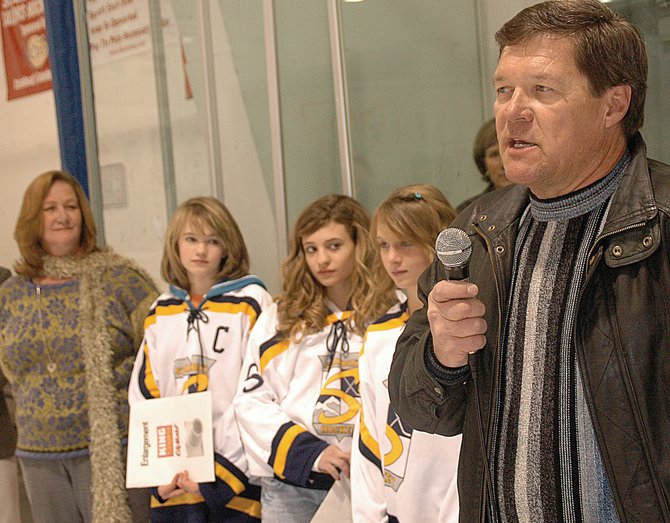 Daryl Dombrowski speaks at Howelsen Ice Arena during the tournament named for his daughter, Adele, who died in 2005, while Adele's mother, Kris Stouffer, from left, Katie Thielemann, Mikenzie Ochs and Sara Stout listen. Dombrowski and Stouffer presented the ADELE award to three local girls hockey players, including Thielemann.
