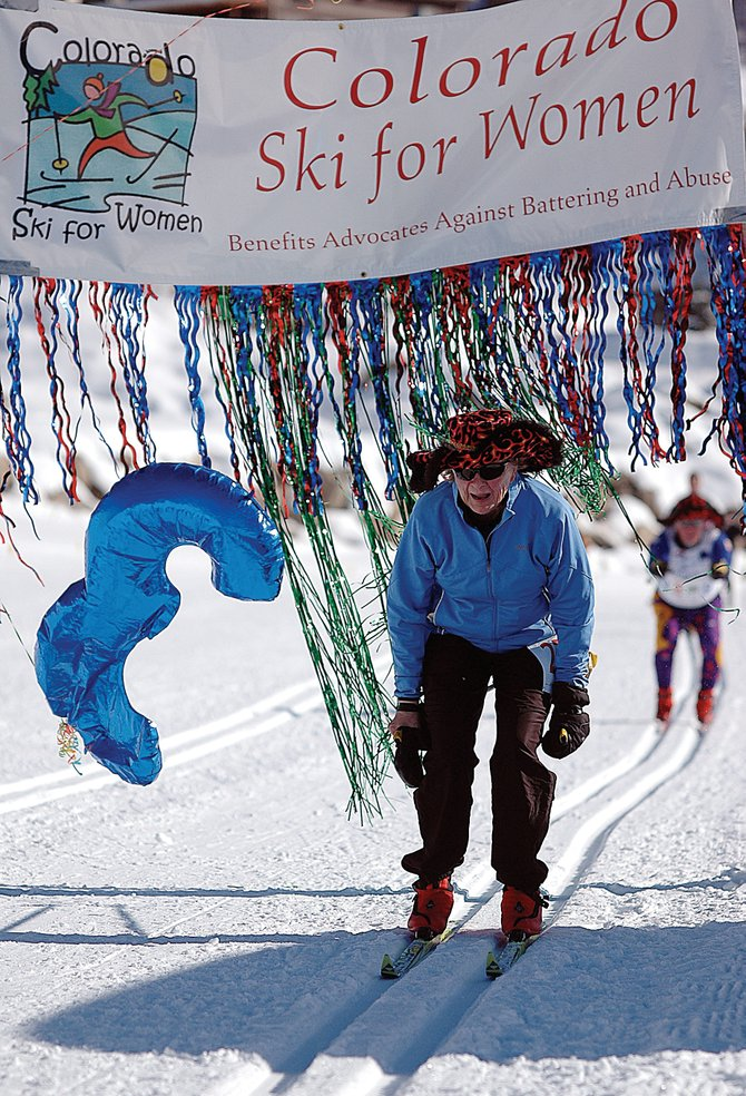 Judy Demers glides across the finish line of Sunday's Colorado Ski For Women event at the Steamboat Ski Touring Center ahead of her husband, Tiger. One-time trainees under Steamboat Springs cross-country skiing legend Sven Wiik, the couple traveled to Steamboat from Kasilof, Alaska.