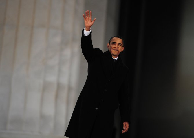 President-elect Barack Obama waves to the thousands gathered at the Lincoln Memorial for the Obama Inauguration Celebration in Washington, D.C., on Sunday. Obama will be sworn in as president at 10 a.m. today.