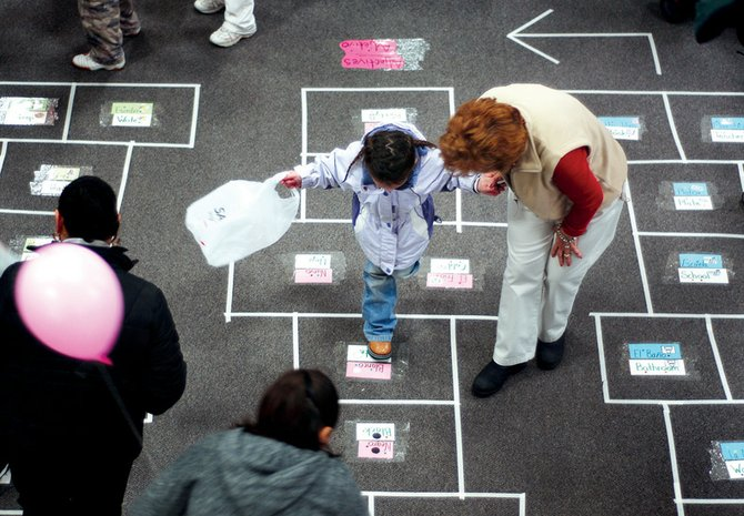"Emma Gines plays ""literary hopscotch"" lead by Martha Martinez at the 2008 Family Literacy Carnival, presented by the Sagebrush Reading Council. This year's carnival is being held at 6 p.m. at Sunset Elementary School."
