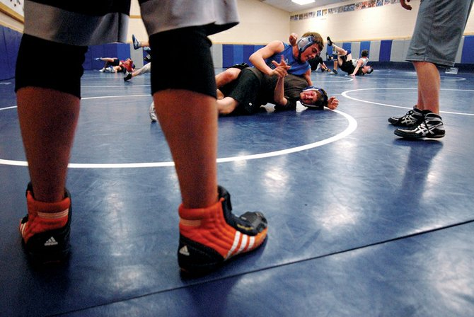 Members of the Moffat County High School wrestling team practice Wednesday in preparation for the team's lone home meet of the season tonight. Meeker High School visits MCHS at 6 p.m.