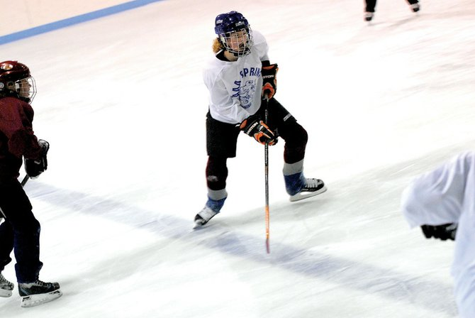 Emily Mahanna, 14, practices Tuesday with her fellow Craig Cougars at the Moffat County Ice Arena. The Cougars recently hosted the Mini Jamboree, which included teams from across the Western Slope.