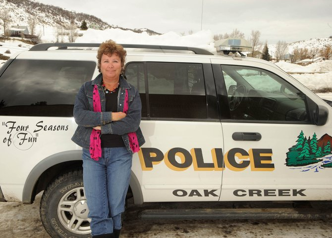 Part-time officer Eileen Rossi loses count when she tries to recall how many bosses she has had at the Oak Creek Police Department. Her law enforcement career has spanned more than 30 years in Georgia and Colorado.
