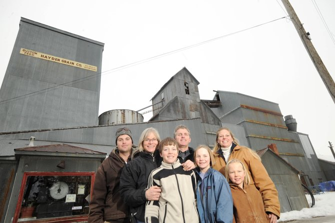 The Delaney family is the new owner of Yampa Valley Feeds in Hayden. Pictured on Thursday in front of the granary are, from right, Sandy Messing, her daughter Karyn Forbes, Millie Delaney, Patrick Delaney, Liam Delaney, Tammie Delaney and her nephew, Robert Bowes. Messing is managing the retail store.