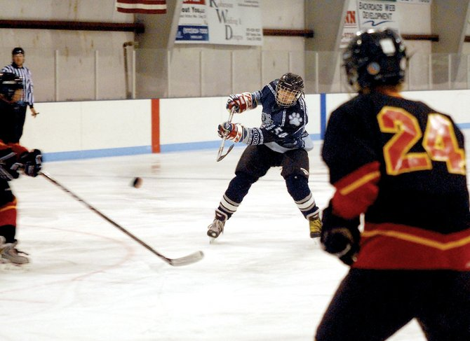 Moffat County Bulldogs Hockey Club member Jacob Baron takes a shot at the goal Sunday against visiting Crested Butte. The Bulldogs tightened their grasp on the fourth and final playoff spot with back-to-back shutout victories against the defending league champions.