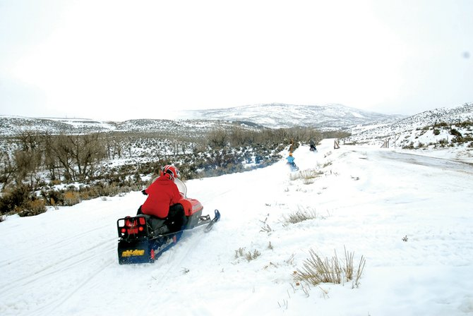 Participants in the Northwest Colorado Snowmobile Club take off at the beginning of the club's annual poker run Saturday. The run covered five stops and more than 30 miles spanning Freeman Reservoir and Black Mountain.