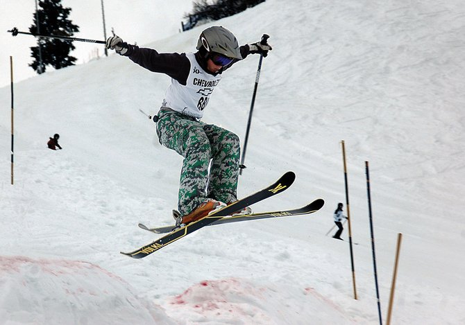 Kane Park, of the Steamboat Springs Winter Sports Club Freestyle program, skis Sunday in a Rocky Mountain Division Development competition at Howelsen Hill. Athletes ranging in age from 10 to 13 swept down the mogul run on the downtown Steamboat ski hill.