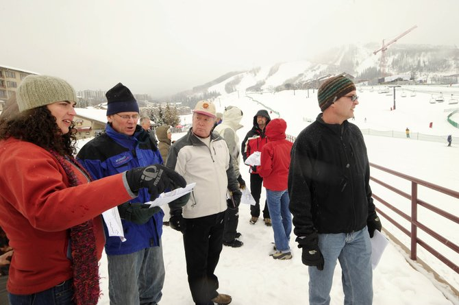 Nicole Horst, a landscape architect with Wenk Associates, speaks to, from right, City Planning Services Manager John Eastman, Timm Harmon and local development consultant Peter Patten during a tour of the base at Steamboat Ski Area on Friday.