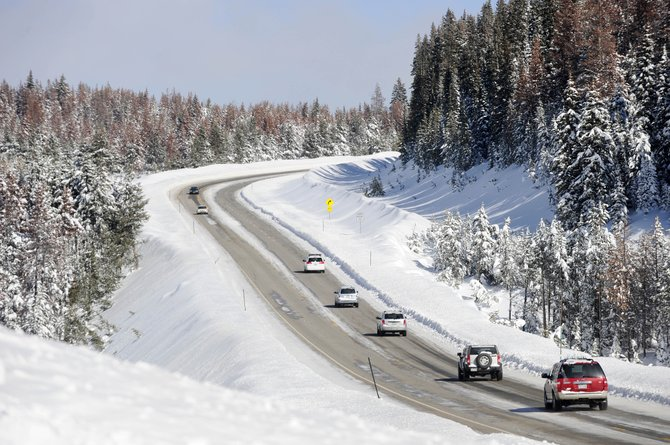 A line of cars travels east Tuesday afternoon on U.S. Highway 40 on Rabbit Ears Pass. Proposed legislation would require slower moving vehicles to pull to the side for faster moving vehicles.