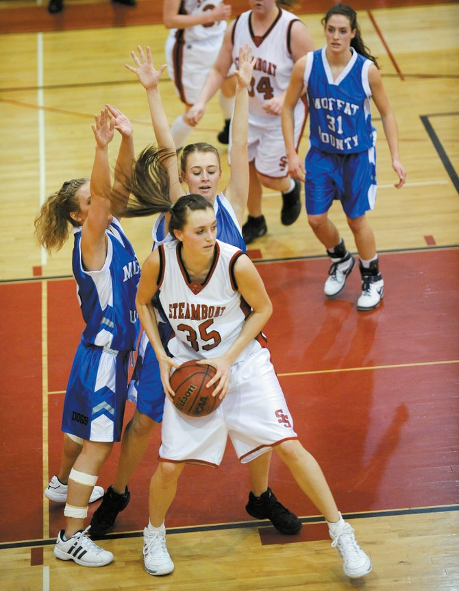 Steamboat Springs High School girls basketball player Colleen King is double-teamed by Moffat County during the second half Tuesday night.
