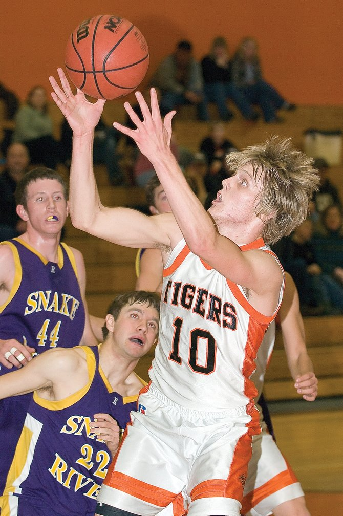 Hayden's Jeremy Engle pulls down a rebound during the Tigers' 66-37 victory against the Little Snake River Valley High School Rattlers on Tuesday night in Hayden.