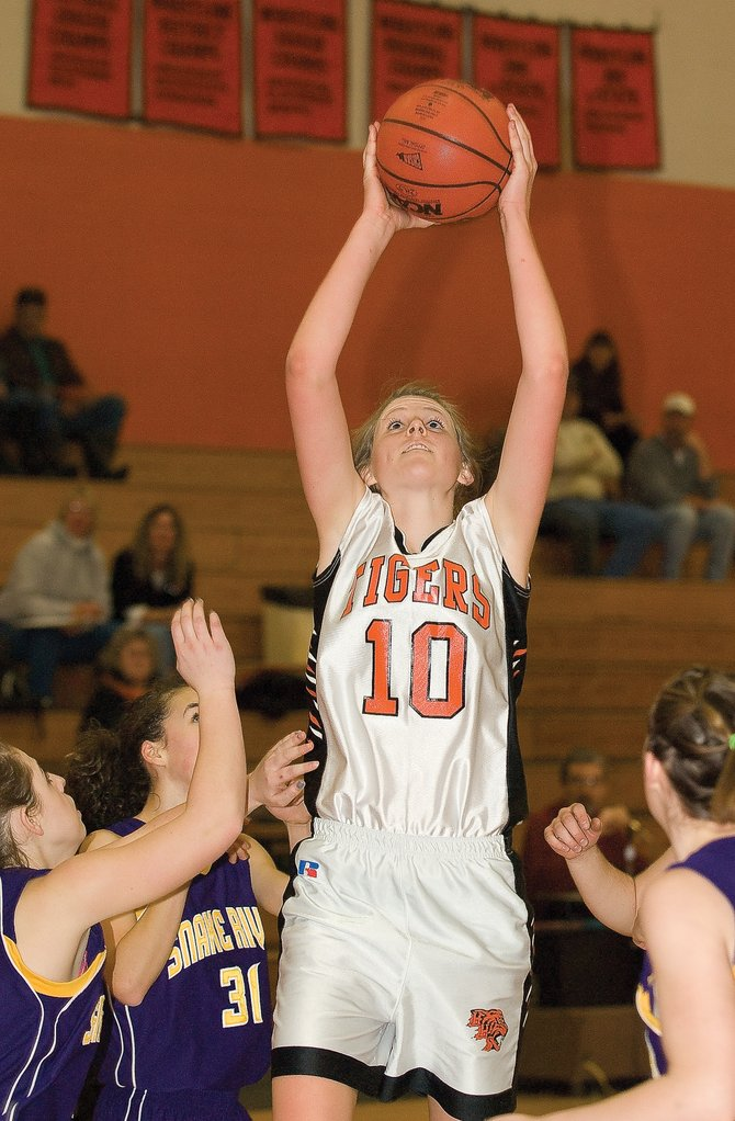 Hayden's Rachael Koehler pulls down a rebound in Tuesday night's game against Little Snake River Valley High School In Hayden. The Tigers rolled past the Rattlers in the second half of the game, winning 66-51.