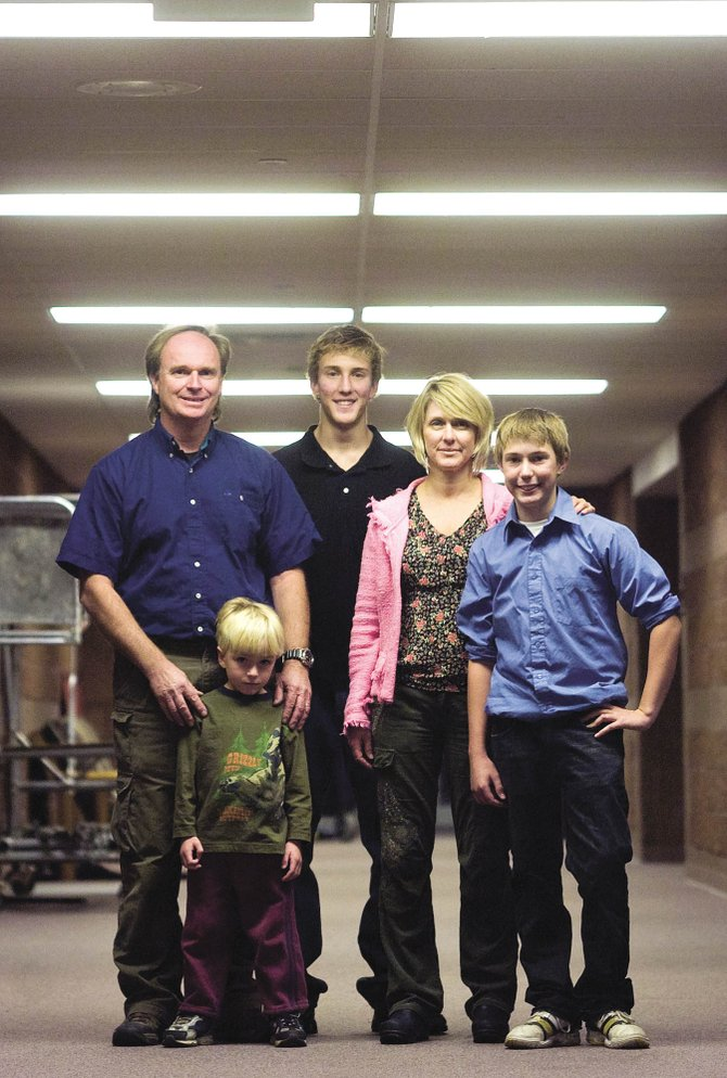 Benji Amsden, from left, and his family Ryyan Amsden, Marc Makens and Susie Makens were all happy to see their son and brother Mike Makens, right, recover from a black widow spider bite he received Sept. 24, 2007, while putting on a sock.