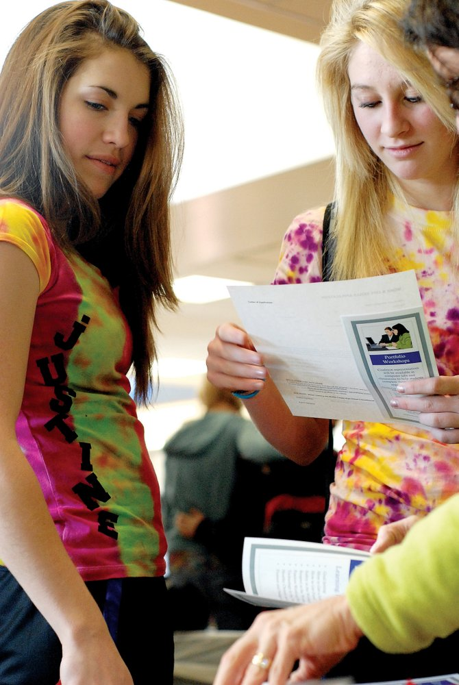 Justine Hathhorn, left, and Callie Papoulas look at information given Tuesday at Moffat County High School for the Moffat County Work and Life Skills program. Orientation for the class begins Monday and Tuesday.