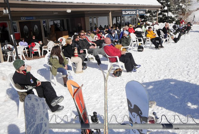 Slopeslide Grill patrons soak up the sun Friday afternoon at the base of Steamboat Ski Area. The ski area had an 8 percent share of Colorado skier days during the 2007-08 season, according to a recently completed Yampa Valley Partners Economic Indicators report.
