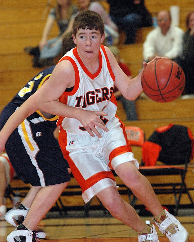 Hayden junior Taylor Branstetter drives toward the basket in Friday night's victory against North Park. Branstetter scored four points in the game and hit one 3-point shot, one of 12 the Tigers poured in during the rout. The team returns to the court today at Rangely.