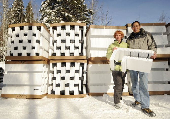 Stagecoach residents Michael and Jo Ann Mow take the delivery of insulated foam blocks Friday that will be used to construct the foundation for their green home. They are the first applicants to go through the Routt County Regional Building Department's pilot Green Building Program.