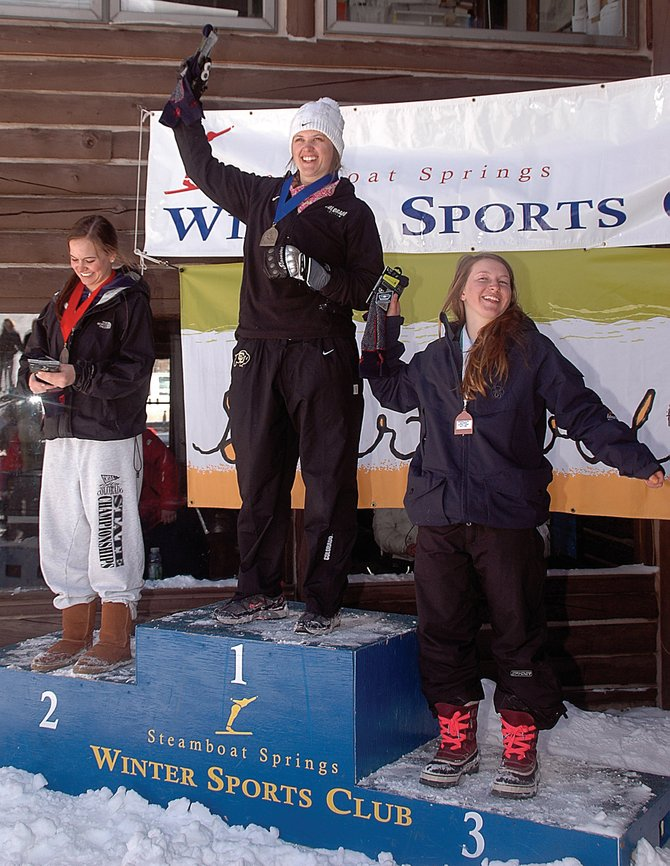 Lisa Perricone, center, celebrates her victory in Saturday's giant slalom race at the Steamboat Ski Area. The all-Steamboat podium included second-place skier Mary Rachel Hostetter and third-place finisher Anna Marno.
