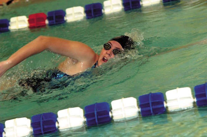 Moffat County senior Megan Knez competes in the 400-meter freestyle relay Jan. 3 during the Bulldog Invite. Knez set a new personal best time in the 50-free Saturday in Glenwood Springs.