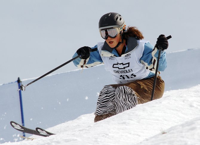 Shelby Dyer, of Steamboat Springs, bounces through bumps during the 2007 Chevrolet Freestyle Junior Olympic mogul event in Steamboat. Local columnist Joanne Palmer recently found that keeping up with a teenager on moguls is a challenging endeavor.