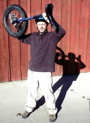 Kevin Morris holds his Kris Holm unicycle. Morris started to take unicycling seriously when he saw skiers in Telluride riding during the summer to keep in shape.