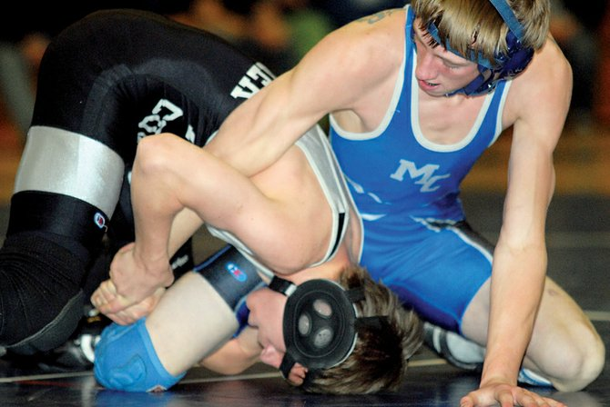 Moffat County High School junior A. C. Crofts competes in January against Meeker during the Bulldog Invite. The MCHS wrestling team wrapped up its regular season schedule with a second-place showing Thursday night in Palisade.