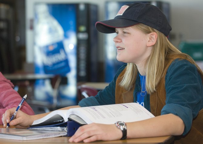 Ninth-grader Jessie Orton studies in the commons area of the Steamboat Springs High School. Students can purchase water, an assortment of diet soda and snacks after 2 p.m. from the vending machines. However, changes by the Colorado Department of Education would eliminate soda from the items that can be purchased at schools across the state.