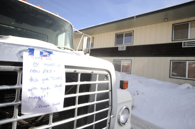A sign from Resort Group on a truck in back of the Iron Horse Inn on Thursday informed its employees to pack their towels with them when they move out of the inn. Resort Group has informed the city they no longer want to manage the facility and started moving their employees who were living there.