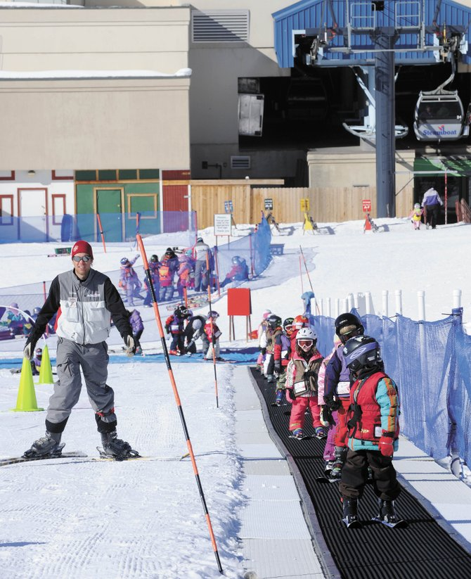 Steamboat Ski and Resort Corp. ski instructor Peter  Thrane skis alongside his class  Wednesday morning. The ski area is about at the halfway point of the season, and Ski Corp. President Chris Diamond is optimistic about the next stretch.