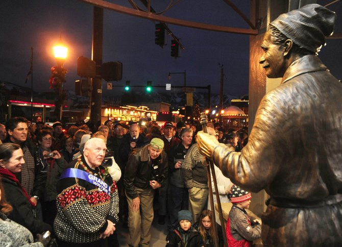 Leif Hovelsen admires the statue of his father, Carl Howelsen, that was unveiled Friday evening at the Howelsen Place building at Seventh Street and Lincoln Avenue.