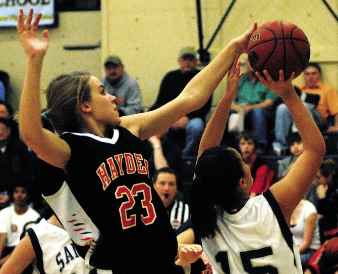 Hayden High School's Erin Koehler, left, blocks the ball from Vail Christian's Tracy Salgado on Saturday in Edwards. The Hayden girls won, 59-22