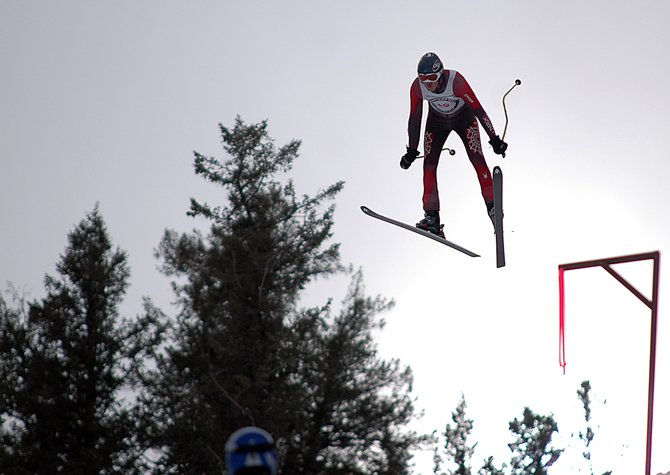 Rolf Wilson lands a jump Saturday during the Pro Alpine Ski Flying competition at Howelsen Hill. Wilson is the current record holder in the sport with a jump of 366 feet. He and 10 other competitors will try to outpace that mark at 1 p.m. today.
