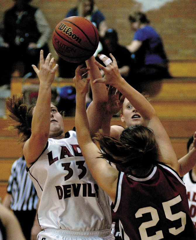 Eagle Valley's Hillary Schott, left, and Steamboat's Emi Birch, foreground, and Hanna Bagland, background, fight for possession of a loose ball Tuesday during their game at Eagle Valley in gypsum. Steamboat won the game, 63-39.