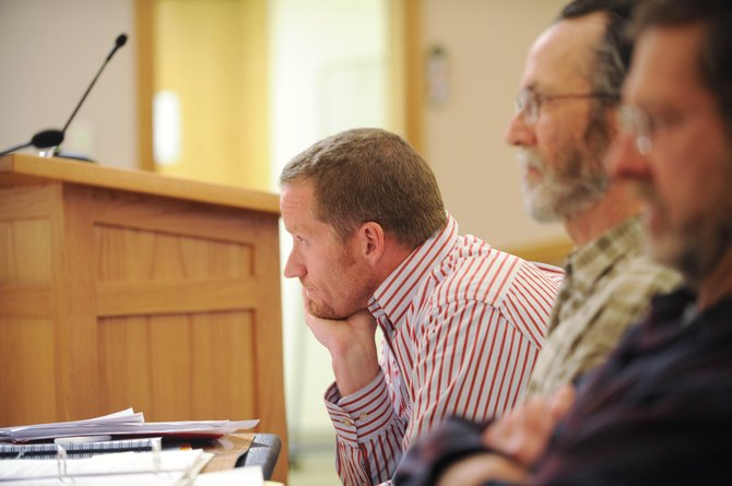 Brent Pearson, a principal and chief financial officer of Resort Ventures West, developer of Wildhorse Meadows, listens to Steamboat Springs City Council members discuss affordable housing requirements Tuesday night.